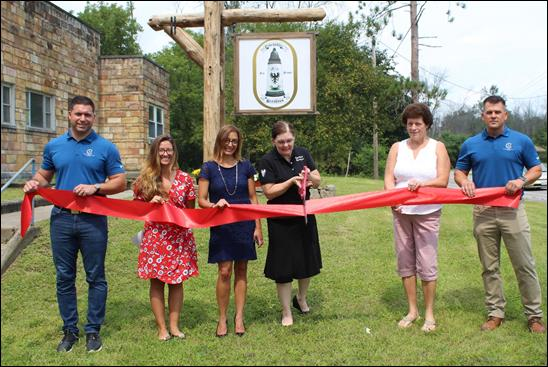 Co-owner Jodie Rodriquez cuts the ribbon at Eisenadler Brauhaus on Wednesday, Aug. 11. Photo courtesy of Montgomery County.