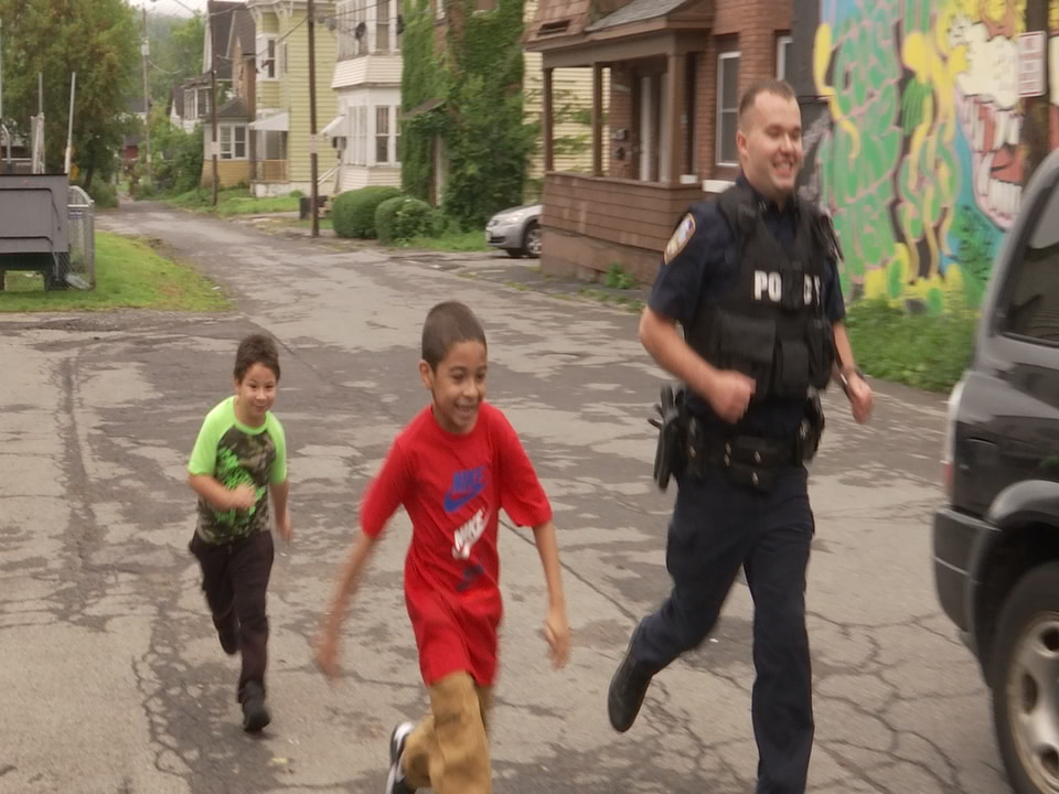 Officer races kids
