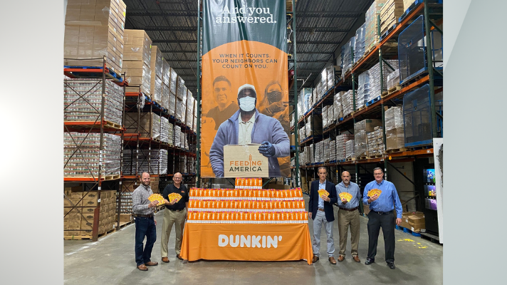 Capital Region Dunkin' franchisees and representatives recognize National Coffee Day with a donation of 300 pounds of coffee and more than $1,000 in gift cards to Regional Food Bank of Northeastern New York in Latham, NY on Monday, September 27.