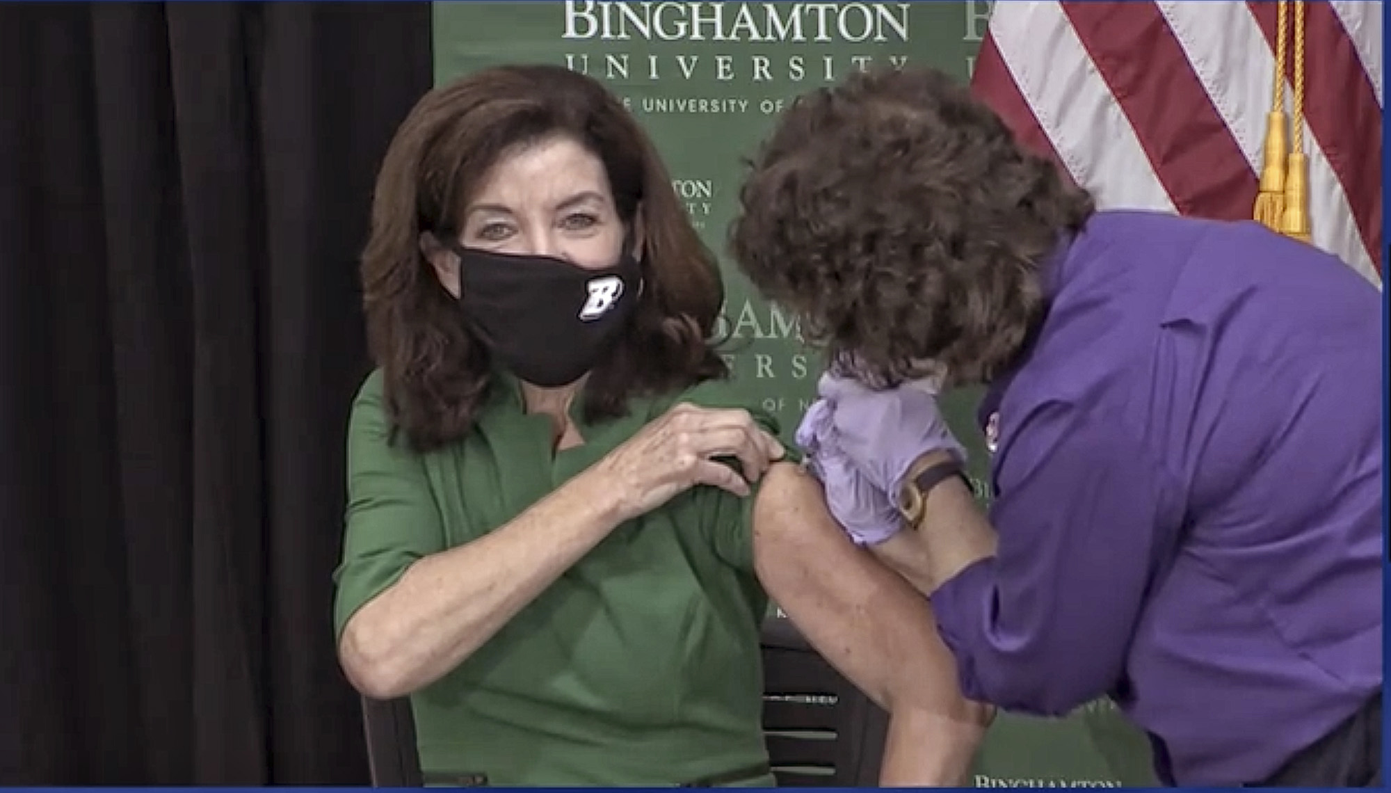 In this image from video provided by the New York Office of the Governor, New York Gov. Kathy Hochul receives her COVID-19 booster shot, at the Decker College of Nursing and Health Sciences, in Johnson City, NY, Monday, Oct. 25, 2021. Gov. Hochul and New York Mayor Bill de Blasio separately received COVID-19 booster shots Monday as part of their efforts to promote widespread vaccinations. (New York Office of the Governor via AP)