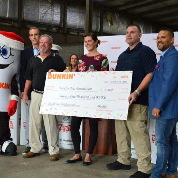 Officials from Capital Region Toys for Tots and Dunkin' were joined by area campaign supporters for Tuesday's kick-off announcement at the Marine Secure Warehouse.